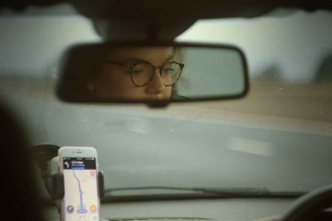 reflection of woman driving car