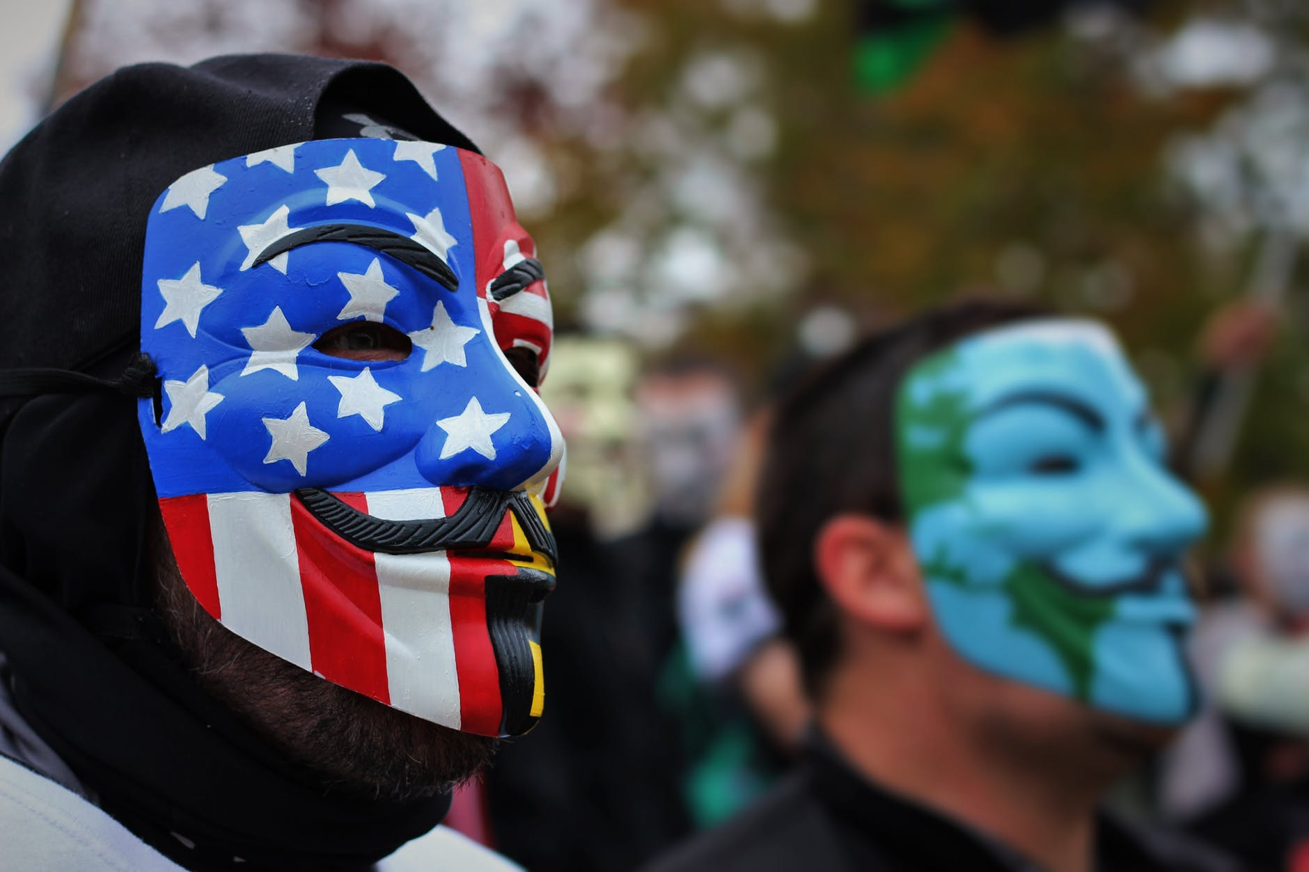 close up photo of person wearing guy fawkes mask