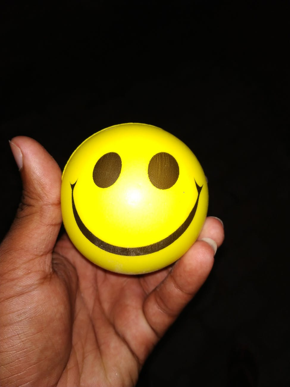 person holding emoticon ball